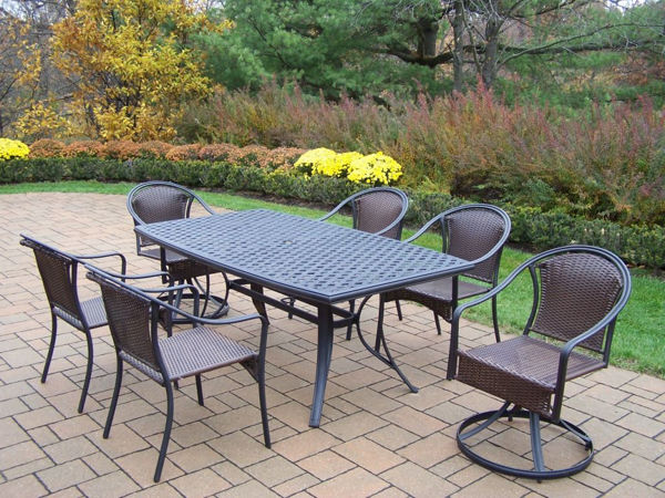Picture of Tuscany 7 Pc. Dining Set with 70x38-inch Aluminum Boat shaped Table,  2 Resin Wicker woven Swivel Chairs, and 4 Stackable Chairs - Black